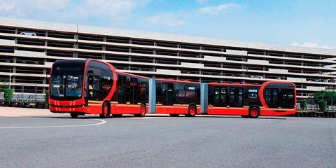Transport, Vehicle, Bus, Mode of transport, Public transport, Bus garage, Car, Urban area, Architecture, Metropolitan area,