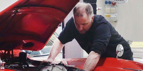 Motor vehicle, Mechanic, Auto mechanic, Automotive design, Hood, Automobile repair shop, Vehicle, Windshield, Car, Automotive wheel system,