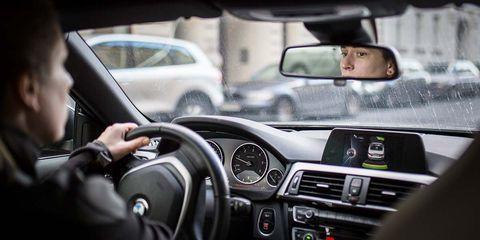 Land vehicle, Vehicle, Car, Personal luxury car, Steering wheel, Luxury vehicle, Steering part, Driving, Automotive mirror, Rear-view mirror,