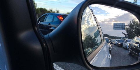 Vehicle, Car, Rear-view mirror, Automotive mirror, Mirror, Vehicle door, Auto part, Reflection, Family car, Automotive side-view mirror,
