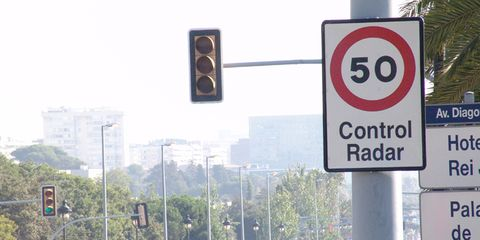 Sign, Street light, Signage, Pole, Street sign, Circle, Traffic sign, Gas, signaling device, Traffic light,