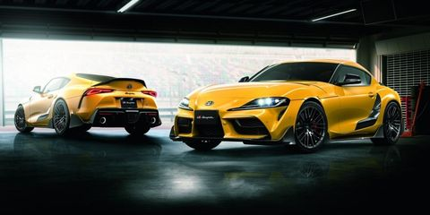 Land vehicle, Vehicle, Car, Sports car, Yellow, Automotive design, Supercar, Performance car, Bumper, Auto show,