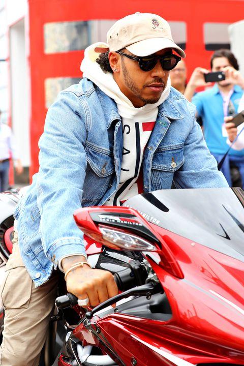 Motor vehicle, Red, Vehicle, Motorcycle, Automotive design, Helmet, Outerwear, Jacket, Headgear, Sunglasses,