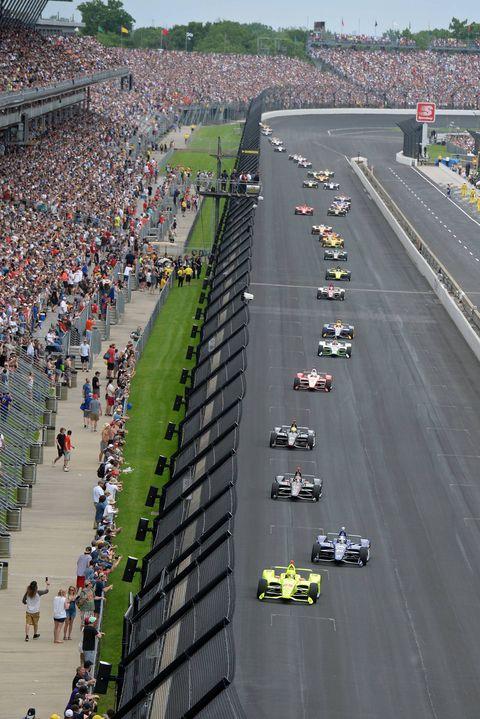 Race track, Crowd, Thoroughfare, Sport venue, Vehicle, Traffic,