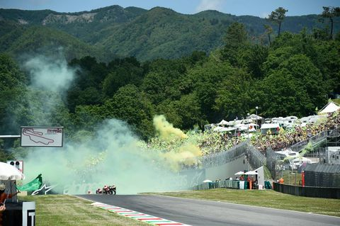 Race track, Smoke, Hill station, Mountain, Vehicle, Tree, Landscape, Road, Tourism, Motorsport,