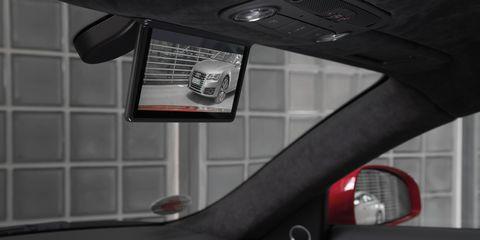 Motor vehicle, Mode of transport, Automotive design, Automotive mirror, Automotive exterior, Glass, Carmine, Rear-view mirror, Windshield, Automotive side-view mirror,