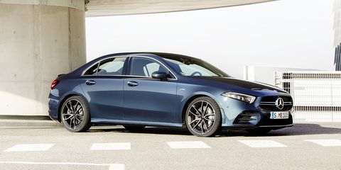 Land vehicle, Vehicle, Car, Automotive design, Mid-size car, Luxury vehicle, Alloy wheel, Personal luxury car, Rim, Tire,
