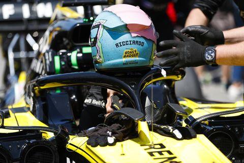 Helmet, Vehicle, Personal protective equipment, Automotive tire, Yellow, Tire, Race track, Car, Automotive design, Kart racing,