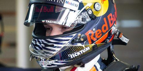 Motorcycle helmet, Helmet, Motorcycle racer, Personal protective equipment, Sports gear, Clothing, Sports equipment, Headgear, Motocross, Vehicle,