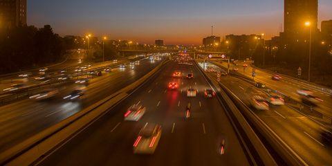 Road, Highway, Freeway, Metropolitan area, Sky, Urban area, Night, Lane, Light, Mode of transport,