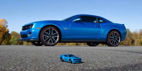 Tire, Wheel, Motor vehicle, Blue, Automotive design, Automotive tire, Vehicle, Alloy wheel, Automotive wheel system, Transport,