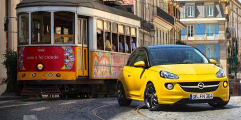 Motor vehicle, Mode of transport, Automotive mirror, Transport, Automotive design, Vehicle, Yellow, Vehicle registration plate, Land vehicle, Window,