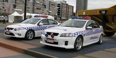Motor vehicle, Vehicle, Land vehicle, Police, Car, Emergency vehicle, Vehicle registration plate, Police car, Full-size car, Emergency service,