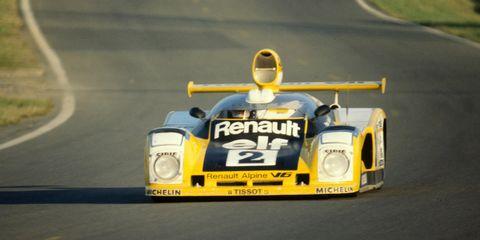 Automotive design, Yellow, Automotive exterior, Asphalt, Motorsport, Headlamp, Sports prototype, Race car, Racing, Logo,