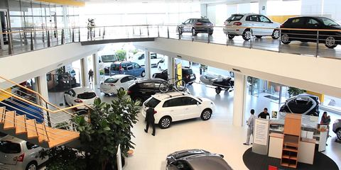 Vehicle, Car dealership, Car, Product, Building, Parking, Retail, City car, Real estate, Subcompact car,