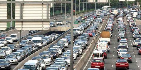 Motor vehicle, Mode of transport, Land vehicle, Vehicle, Transport, Automotive parking light, Automotive design, City, Automotive exterior, Car,