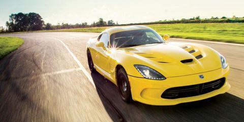Automotive design, Yellow, Vehicle, Hood, Land vehicle, Road, Performance car, Car, Plain, Fender,