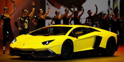 Tire, Wheel, Mode of transport, Automotive design, Vehicle, Yellow, Transport, Rim, Supercar, Car,