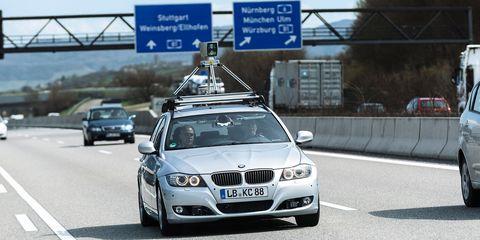 Automotive mirror, Mode of transport, Automotive design, Vehicle, Road, Land vehicle, Automotive lighting, Vehicle registration plate, Automotive parking light, Automotive exterior,