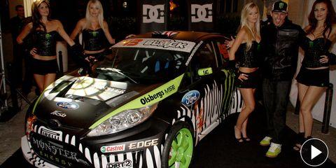 Automotive design, Vehicle, Dress, Car, Headlamp, Goggles, Hatchback, Race car, Logo, Auto show,