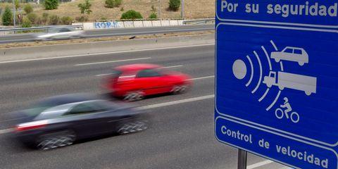 Motor vehicle, Road, Asphalt, Road surface, Sign, Signage, Lane, Automotive mirror, Thoroughfare, Highway,