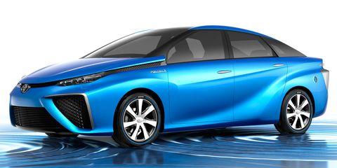 Wheel, Motor vehicle, Tire, Mode of transport, Automotive design, Automotive mirror, Blue, Vehicle, Transport, Land vehicle,