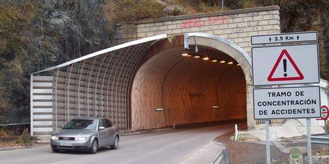 Road, Automotive parking light, Road surface, Infrastructure, Car, Asphalt, Automotive lighting, Tunnel, Automotive mirror, Signage,