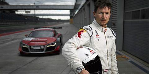 Automotive design, Vehicle, Sports uniform, Car, Grille, Race track, Sports car, Bumper, Watch, Performance car,