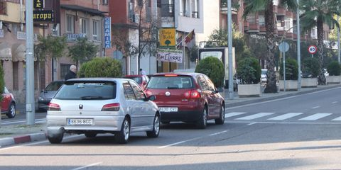 Wheel, Automotive tail & brake light, Automotive design, Vehicle, Land vehicle, Window, Neighbourhood, Road, Car, Automotive exterior,