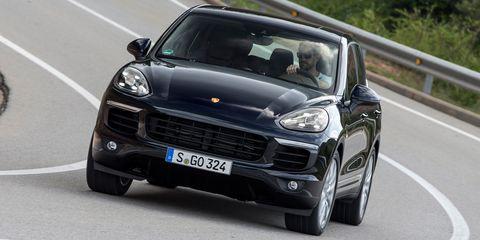 Tire, Automotive design, Vehicle, Hood, Road, Automotive mirror, Headlamp, Vehicle registration plate, Grille, Car,