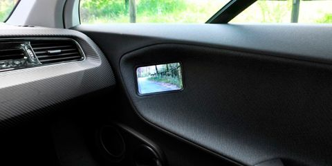 Motor vehicle, Automotive exterior, Vehicle door, Automotive mirror, Fixture, Tints and shades, Automotive door part, Automotive side-view mirror, Automotive window part, Windshield,