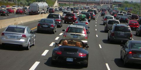 Motor vehicle, Mode of transport, Automotive tail & brake light, Land vehicle, Vehicle, Automotive design, Car, Automotive parking light, Automotive mirror, Vehicle registration plate,