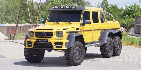 Tire, Motor vehicle, Wheel, Mode of transport, Automotive tire, Vehicle, Yellow, Transport, Land vehicle, Automotive design,