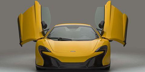 Motor vehicle, Mode of transport, Automotive design, Yellow, Transport, Vehicle, Land vehicle, Car, Automotive exterior, Vehicle door,