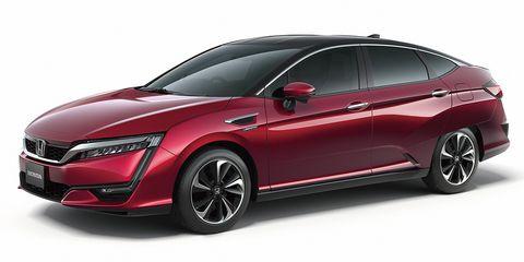 Tire, Wheel, Mode of transport, Automotive design, Automotive mirror, Vehicle, Car, Red, Glass, Automotive exterior,