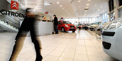 Motor vehicle, Automotive design, Floor, Automotive lighting, Alloy wheel, Parking, Hatchback, Luxury vehicle, Parking lot, City car,
