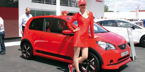 Tire, Wheel, Automotive design, Land vehicle, Vehicle, Cap, Car, Hatchback, Red, Alloy wheel,