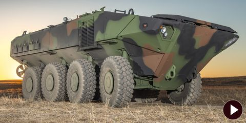 Motor vehicle, Wheel, Mode of transport, Combat vehicle, Military vehicle, Green, Self-propelled artillery, Armored car, Auto part, Machine,