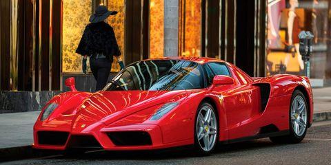 Tire, Mode of transport, Automotive design, Vehicle, Car, Transport, Hat, Supercar, Red, Sports car,