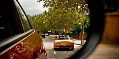 Motor vehicle, Automotive design, Automotive mirror, Mode of transport, Yellow, Automotive lighting, Vehicle, Automotive parking light, Car, Headlamp,