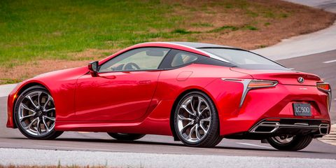 Tire, Wheel, Automotive design, Vehicle, Rim, Alloy wheel, Performance car, Red, Car, Supercar,