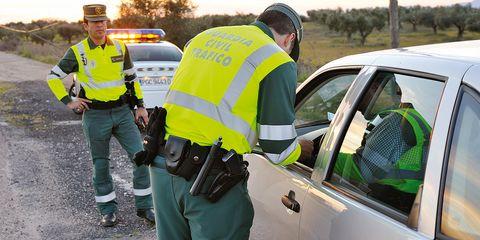 Motor vehicle, Land vehicle, Police, Car, Emergency service, Vehicle door, Police officer, Law enforcement, Uniform, Security,
