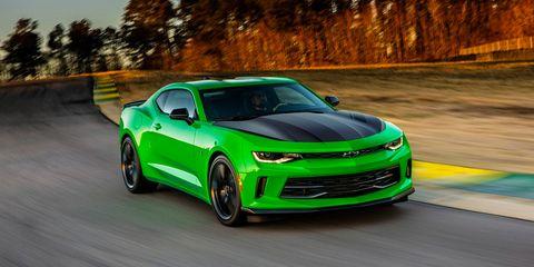 Automotive design, Vehicle, Green, Hood, Chevrolet camaro, Headlamp, Infrastructure, Automotive tire, Automotive lighting, Performance car,