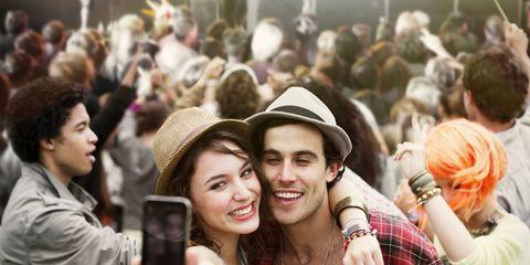 People, Hat, Crowd, Plaid, Tartan, Hand, Fashion accessory, Headgear, Pattern, Jacket,