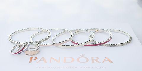 Jewellery, Fashion accessory, Bangle, Body jewelry, Metal, Silver, Font, Bracelet, Platinum, Circle,