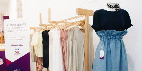 Clothes hanger, Clothing, Boutique, Dress, Room, Shoulder, Fashion, Costume design, Textile, Formal wear,