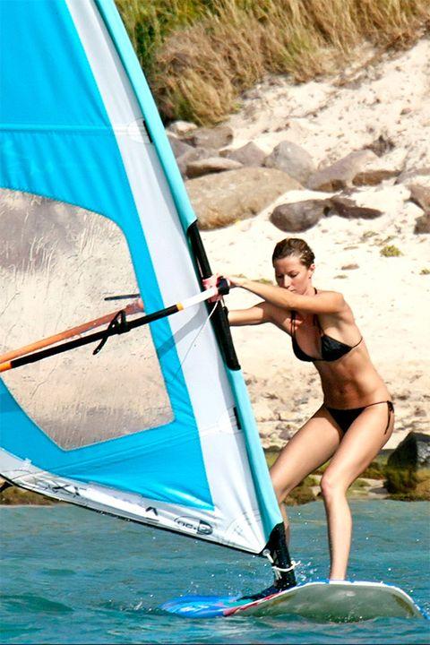 Windsurfing, Water transportation, Surface water sports, Boardsport, Recreation, Outdoor recreation, Surfing, Water sport, Sail, Vehicle,