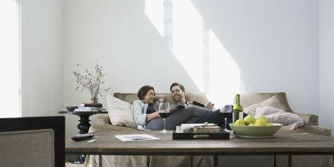 Room, Interior design, Table, Furniture, Interior design, Comfort, Coffee table, Grey, Living room, Home,
