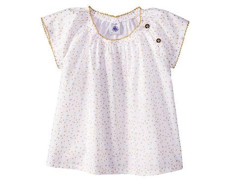 ab26a815a Original blusa con estampado de cerezas en tono dorado sobre fondo blanco,  de manga corta y cuello redondo. Lleva el cierre con dos botones en el  lateral y ...
