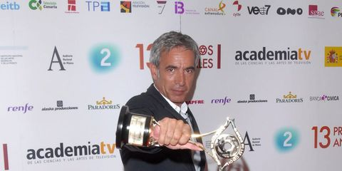 Award, Carpet, Flooring, Logo, Award ceremony, Premiere, Trophy, Suit trousers,